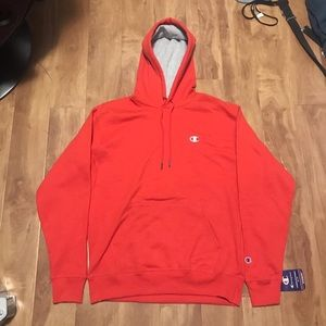 Red champion hoodie.
